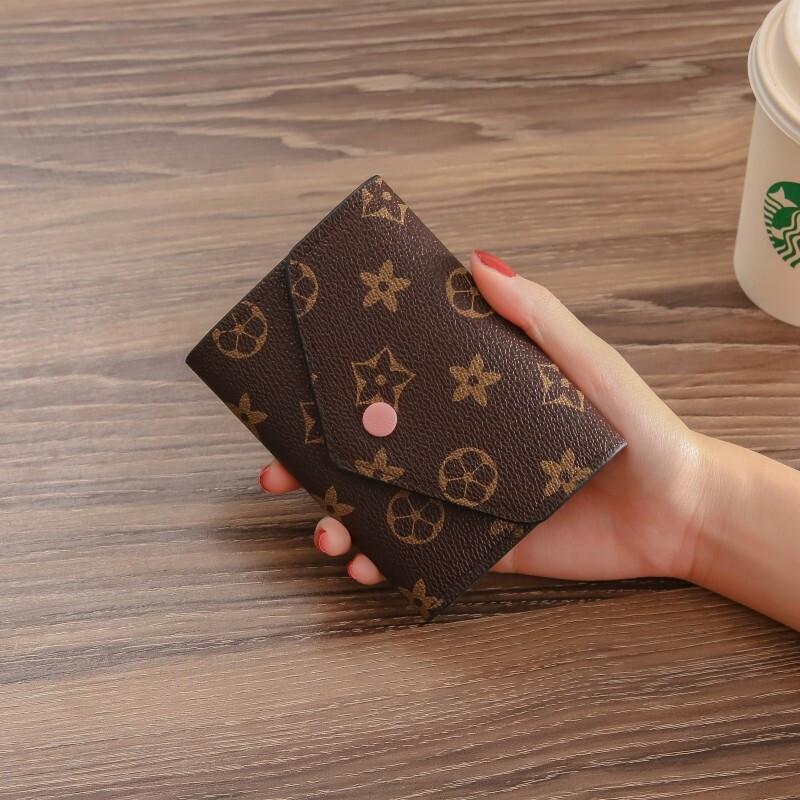 새로운 유럽 과 미국의 복고 지갑 여자 의 짧 은 기능 폴 더 링 제로 지갑 대 용량 미니 카드 지갑 여자 지갑 트 렌 디 핑크